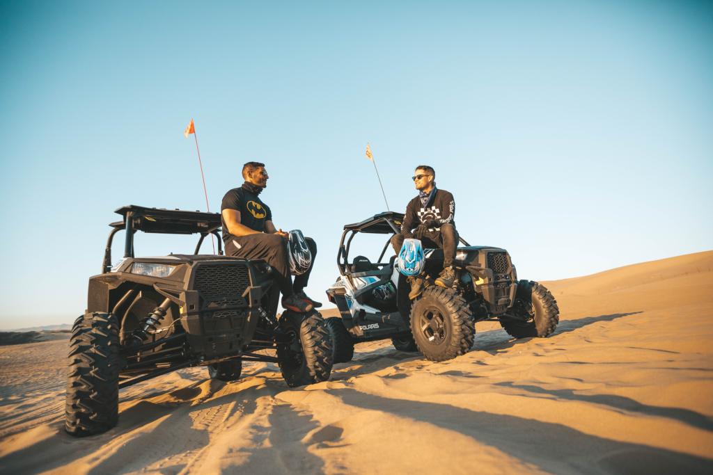Guys in the desert on dune buggies